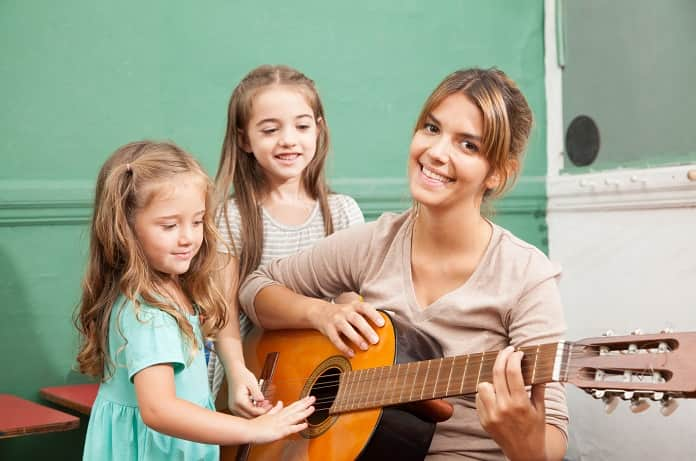 music-therapy-teacher-with-children-min